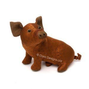 Rusty pig doorstop
